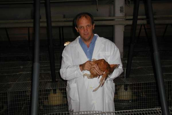 Gary Butcher holding a chicken